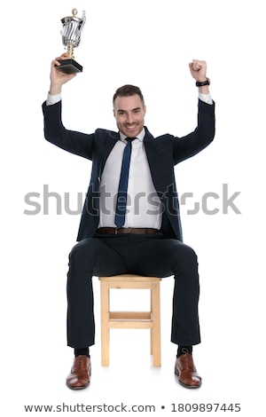 business man sitting on a stool while looking up Stock photo © feedough
