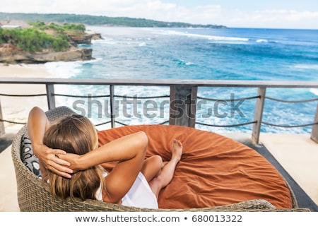 young beauty woman in lounge on veranda on sea Stock photo © Paha_L