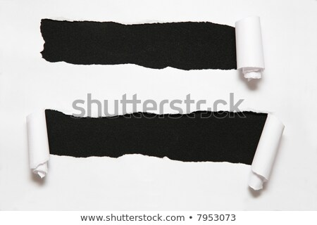 the sheet of paper with two holes against the black background Stock photo © Paha_L