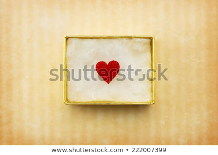 Gift of love. hearty gift. A gift box with a red heart inside. stock photo © teerawit