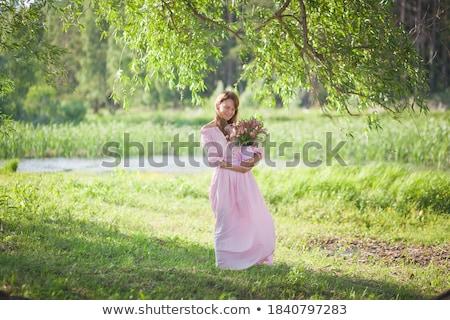 gorgeous brunette beauty in a old fashioned dress in a forest stock photo © konradbak