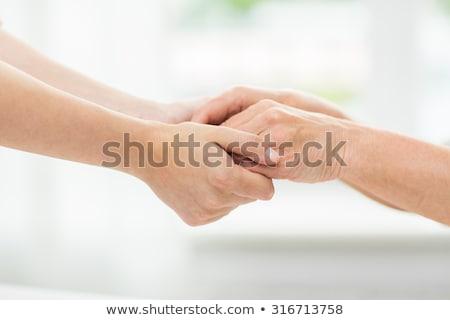 oude · man · jonge · vrouw · holding · handen · ouderdom · ondersteuning - stockfoto © dolgachov