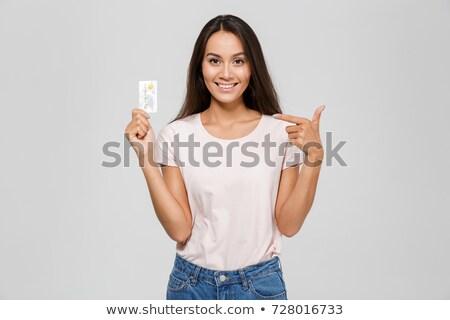 таблетки · привлекательный · улыбающаяся · женщина · изолированный · белый - Сток-фото © deandrobot