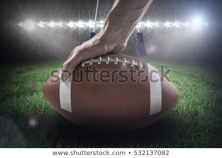 Composite image 3D of american football player placing the ball Stock photo © wavebreak_media
