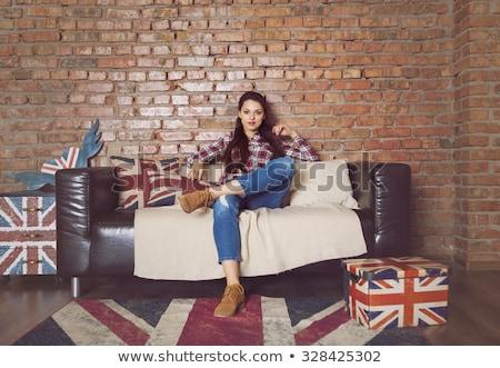 girl poses on brown sofa Stock photo © ssuaphoto