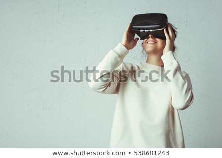 Stock photo: Woman wearing VR Virtual Reality Headset with Interface