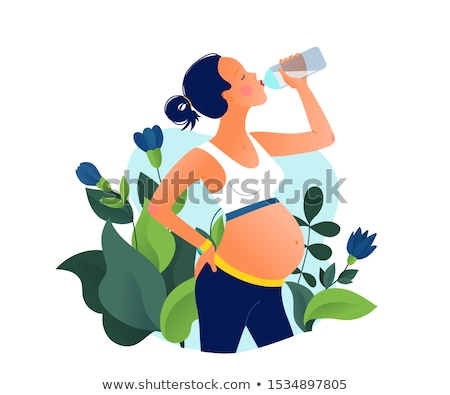 young pregnant woman drinking water after exercises stock photo © julenochek