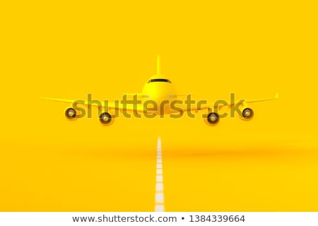 Stock photo: Yellow airplane flies