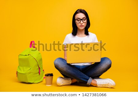 female model in tshirt and jean shorts sitting on her knees isolated stock photo © julenochek