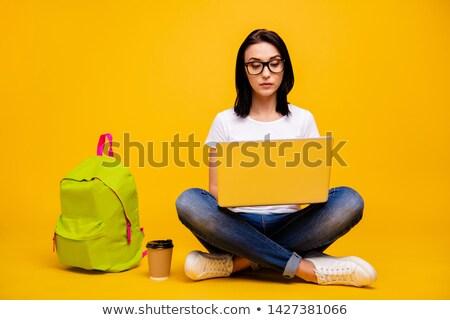 Kadın model tshirt şort oturma yalıtılmış Stok fotoğraf © julenochek