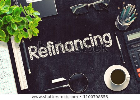 Handwritten Refinancing on a Chalkboard. Stock photo © tashatuvango