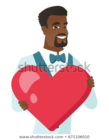 Young african-american groom holding a big heart. Stock photo © RAStudio