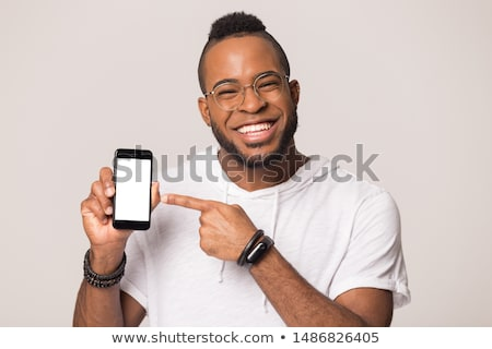 Man smiling holding cell phone Stock photo © IS2