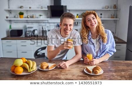 Couple preparing fruit juice Stock photo © wavebreak_media