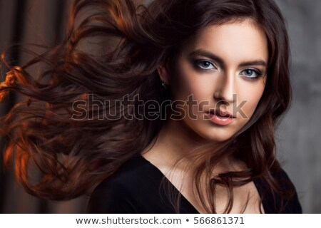 Close up beauty portrait of a delighted brown haired woman Stock photo © deandrobot