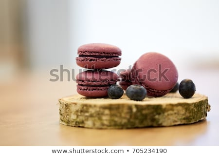 blueberry macarons on wooden stand Stock photo © dolgachov