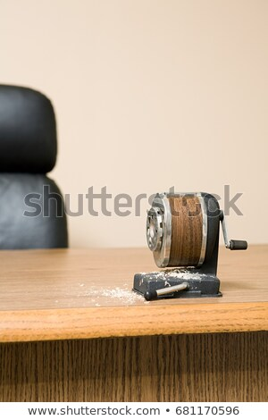 Old fashioned pencil sharpener on office desk surrounded by pencil shavings Stock photo © IS2