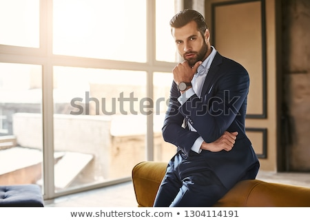 handsome businessman in suit resting Stock photo © svetography