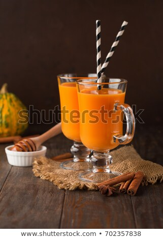 Healthy carrot smoothie with orange and cinnamon in glass Stock photo © Melnyk