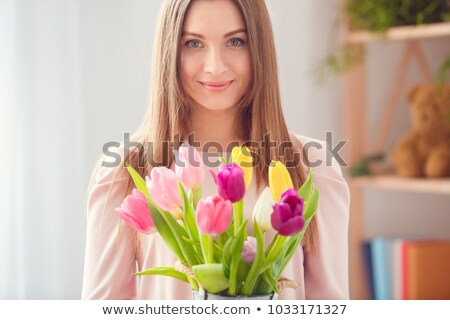 Smiling woman with bunch of flowers Stock photo © konradbak