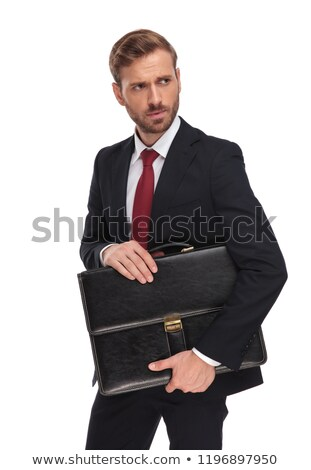 anxious blonde businessman with suitcase looks to side Stock photo © feedough