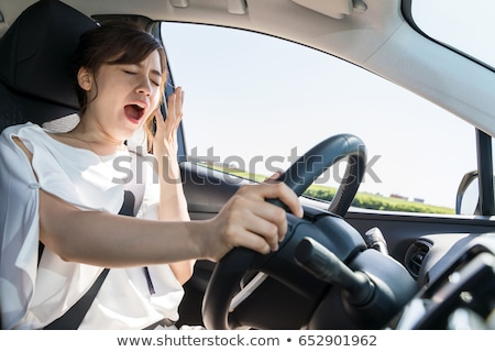 Woman Yawning Inside Car Stock photo © AndreyPopov
