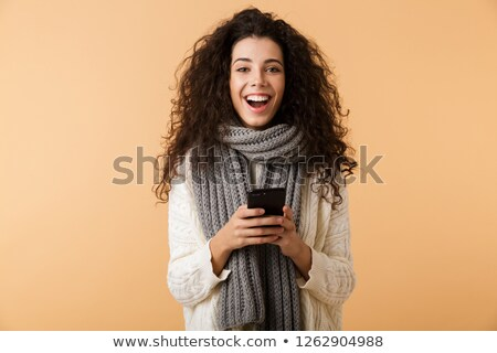 Pretty young girl wearing sweater standing Stock photo © deandrobot