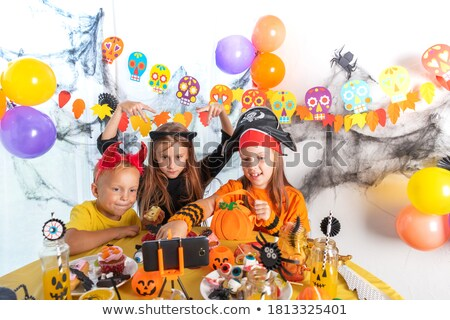 Group of cheerful friends dressed in scary costumes Stock photo © deandrobot