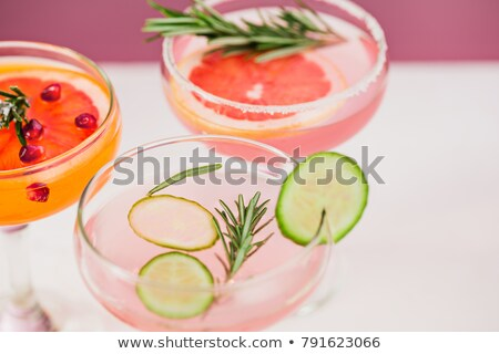 Glass of Aperol Spritz cocktail by the pool  Stock photo © dashapetrenko