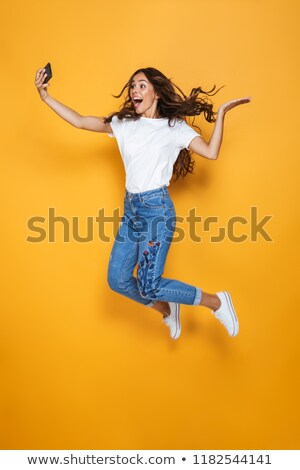 Foto alegre mulher longo cabelo escuro Foto stock © deandrobot