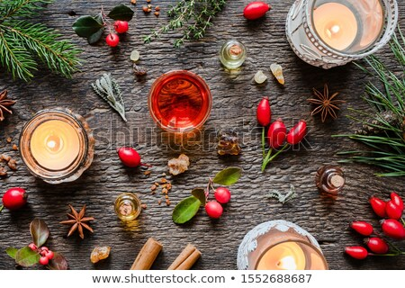 christmas selection of essential oils with frankincense wintergreen cinnamon stock photo © madeleine_steinbach