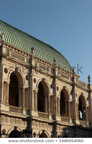 statue at basilica palladiana with copper roof in vicenza city i stock photo © boggy