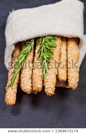 Italian grissini bread sticks with rosemary herb on linen napkin Stock photo © marylooo
