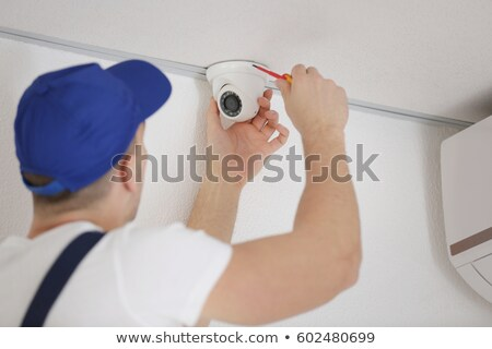 Surveillance camera suspended from the ceiling Stock photo © Giulio_Fornasar