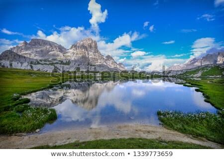 Tervek tó három napfény felhők víz Stock fotó © frimufilms