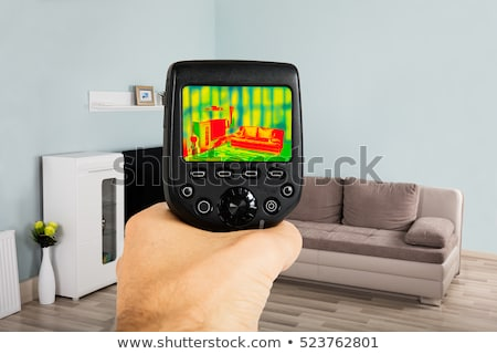 Stock foto: Using Infrared Thermal Camera In Living Room