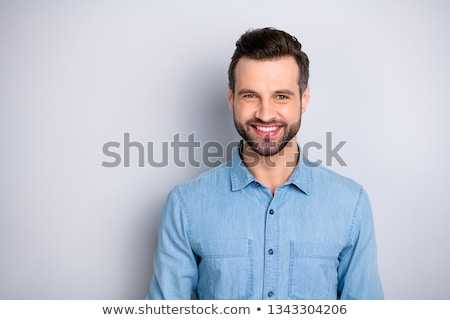 Photo of attractive bearded male wears fashionable clothing, shr Stock photo © vkstudio