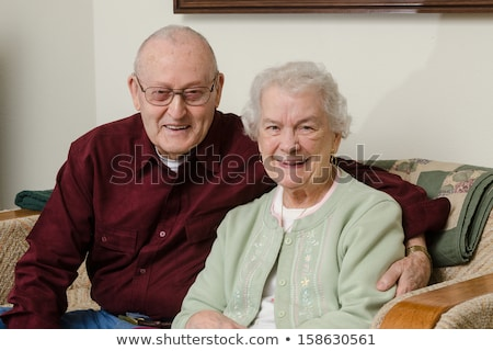 Close-up portrait of an elder couple at home Stock photo © Lopolo