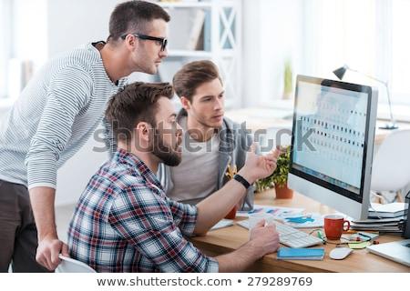три молодые люди глядя компьютер работу студент Сток-фото © photography33