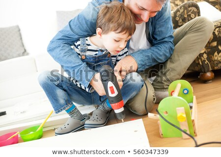 Father and son assembling furniture Stock photo © photography33