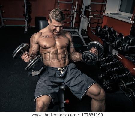 Homem halteres forte posando sem camisa preto Foto stock © chesterf