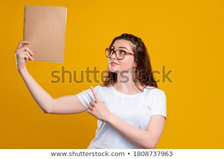 Motivated woman pointing to blank copyspace Stock photo © fantasticrabbit