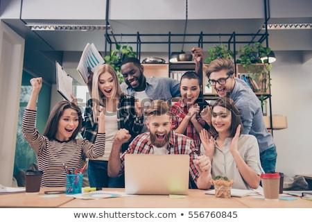 businesspeople - happy laptop team stock photo © dgilder