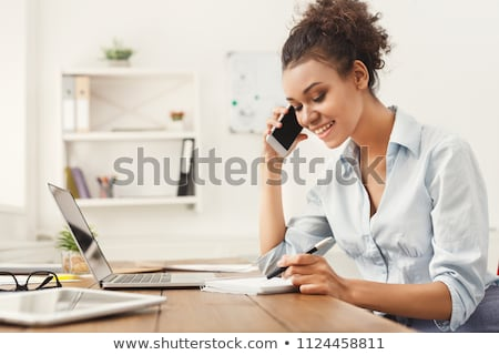 Stock photo: businesswoman talking on mobile