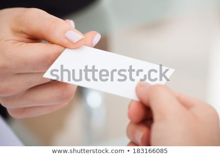 Stock photo: Businesspeople Holding Visiting Card
