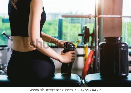 тонкий молодые блондинка черный спортивная одежда позируют Сток-фото © acidgrey