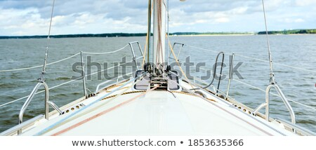 boat sailing blue calm ocean sea bow railing Stock photo © lunamarina