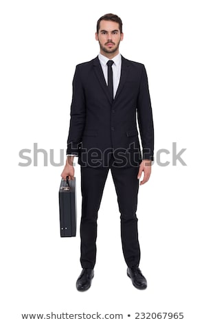 young man holding briefcase isolated on white stock photo © elnur
