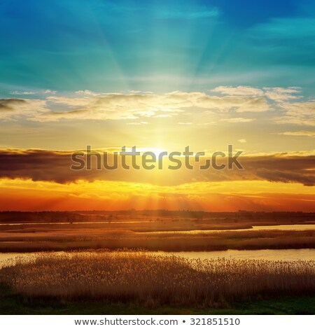 Sunset/sunrise over river Stock photo © razvanphotos