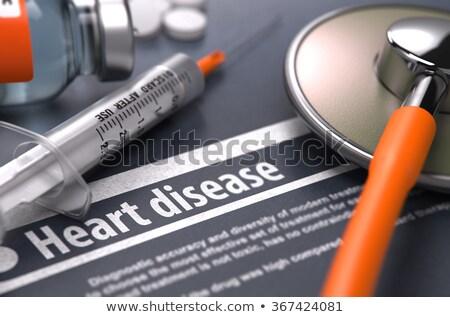Wydrukowane diagnoza medycznych pomarańczowy stetoskop pigułki Zdjęcia stock © tashatuvango